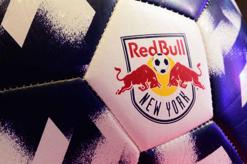 The New York Red Bulls logo on a soccer ball.